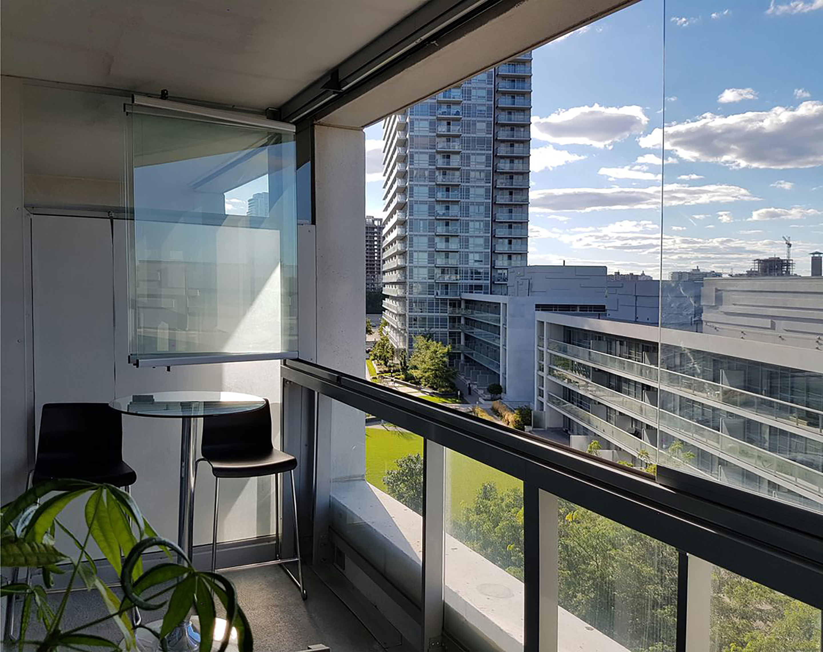 Lumon Canada balcony glazing system providing residents with an unobstructed view of their city. Enclosures can be found all over Canada, include toronto, vancouver and hamilton