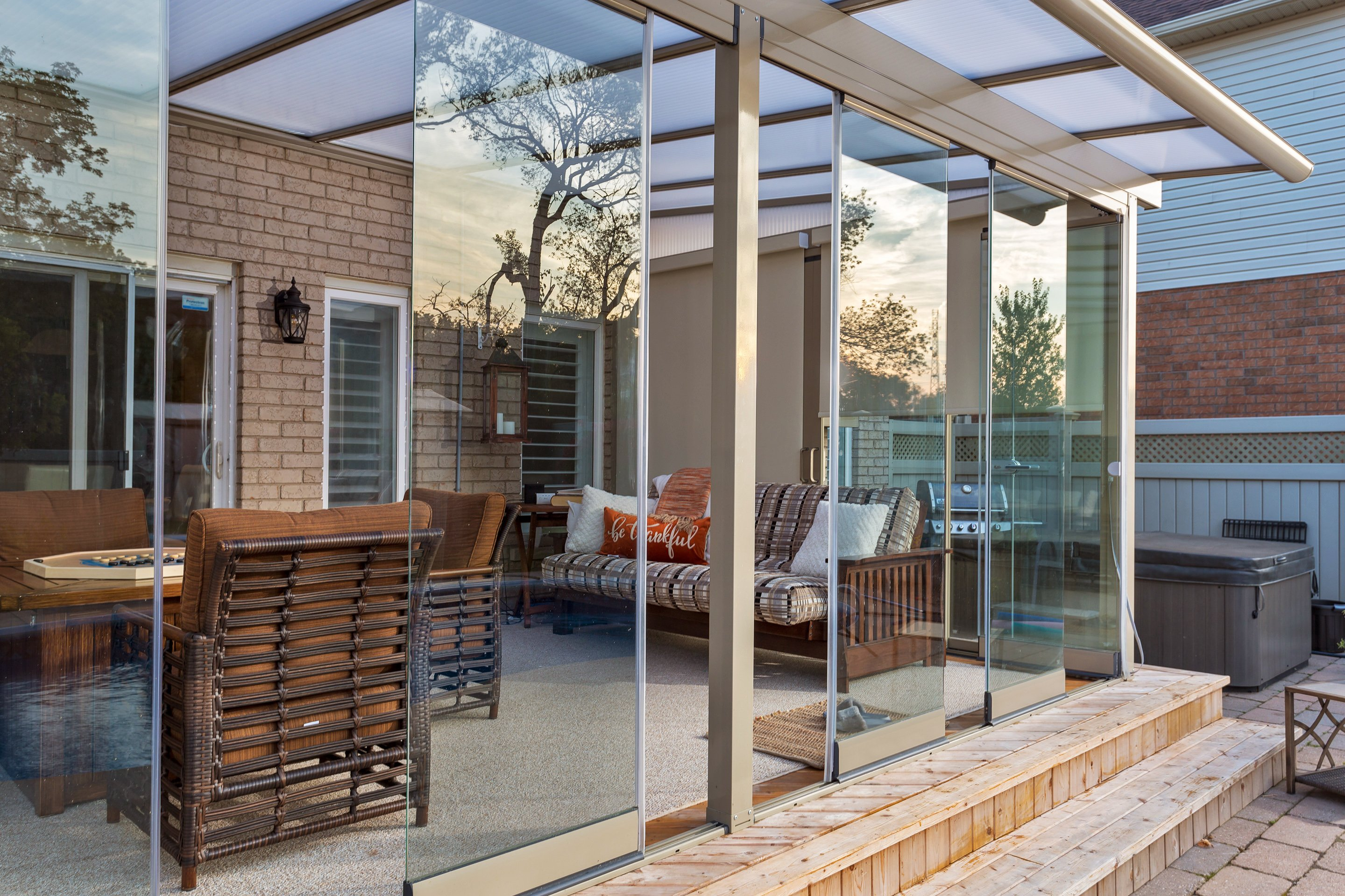sunroom, sunroom enclosure, retractable glass walls, sliding glass, sliding glass wall, sliding glass walls, glass enclosure, glass enclosures, glass walls,, retractable walls, tempered glass wall, tempered glass walls, frameless retractable glass,