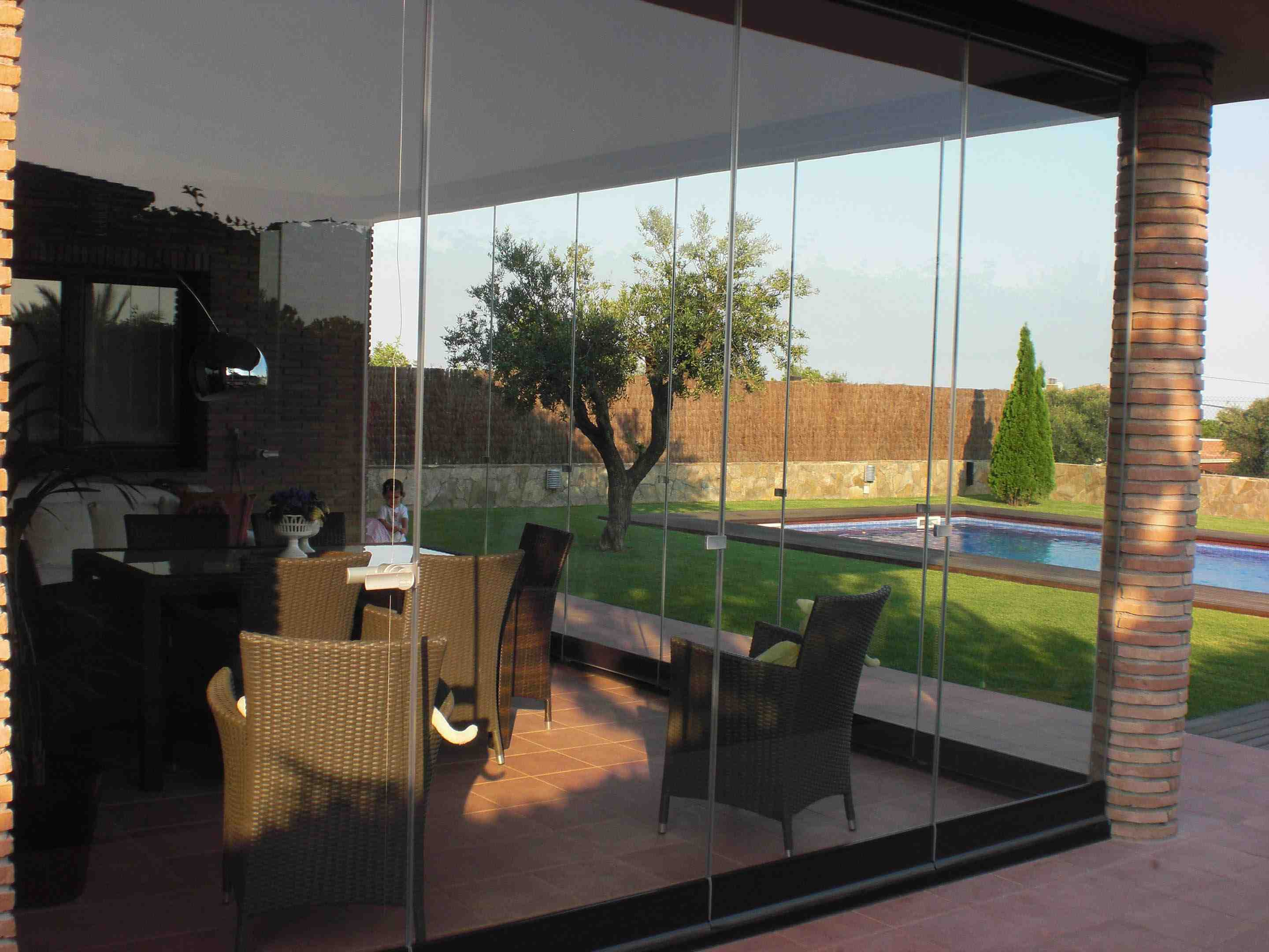 glass walls, frameless glass walls, all season sunroom, add sunroom to house, beautiful sunroom