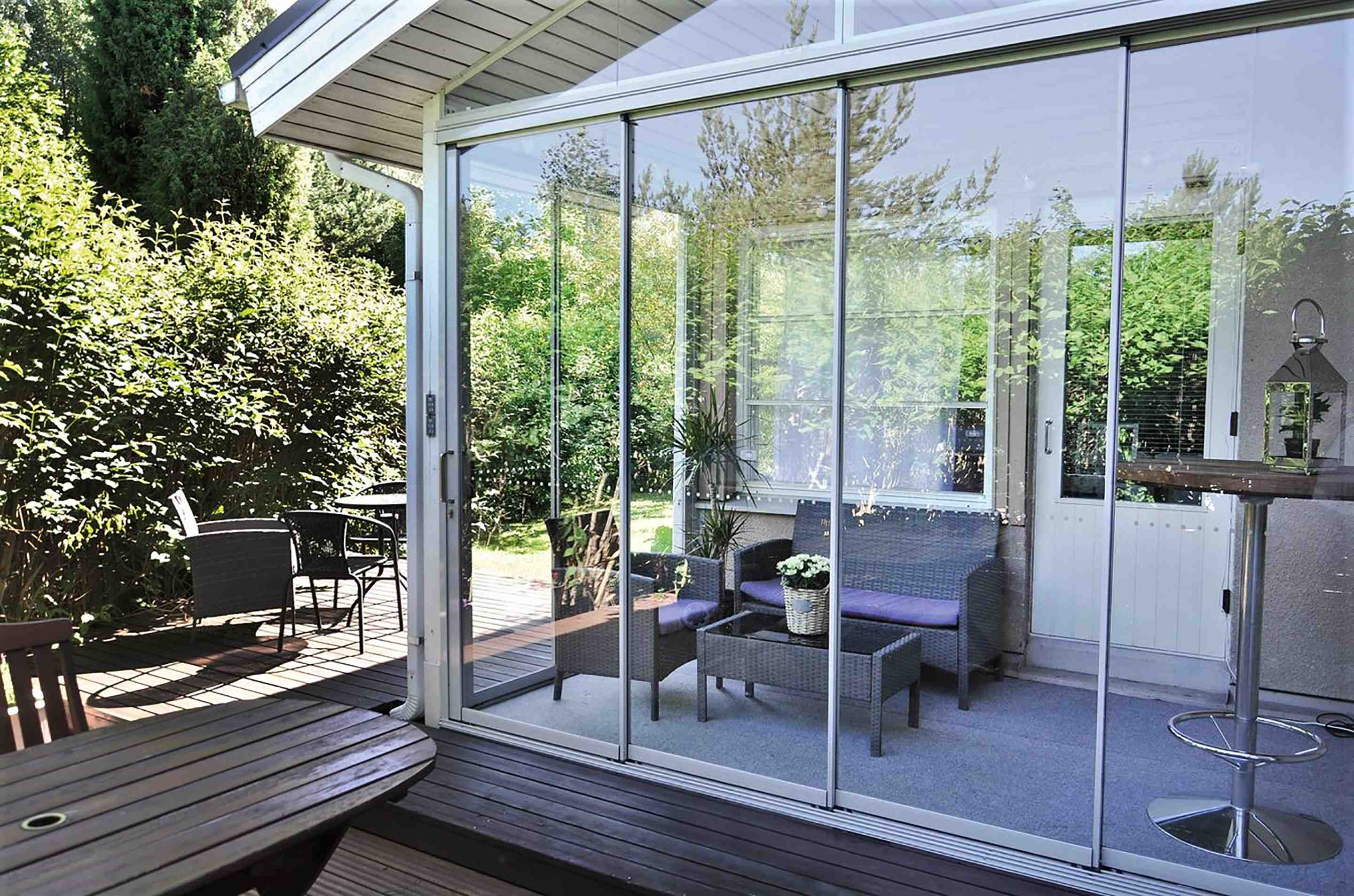 glass sunroom, glass porch enclosures, lifestyle sunrooms, lifestyle sunroom reviews, moveable patio walls, glass walls, sunroom ideas, porch enclosures, sun room , sun room extension, sunrooms